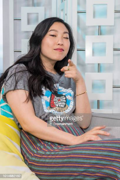 Crazy Rich Asians star Awkwafina poses for a photo onset during the filming of E's Daily Pop