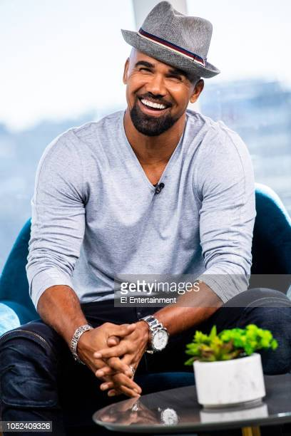 Actor Shemar Moore poses for pictures on set