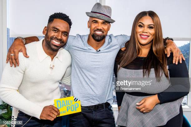 CoHost Justin Sylvester Actor Shemar Moore and Host Nina Parker pose for a picture on set