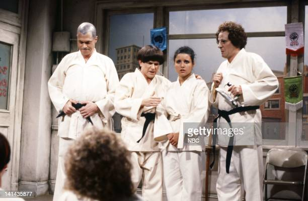 Joe Piscopo as Curly Tim Kazurinsky as Moe Julia LouisDreyfus as student Betty Thomas as student during the 'Karate School' skit on May 12 1984 Photo...