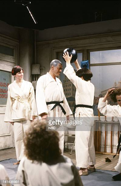 Mary Gross as student Joe Piscopo as Curly Tim Kazurinsky as Moe during the 'Karate School' skit on May 12 1984 Photo by NBC/NBCU Photo Bank