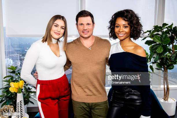 Daily Pop Host Carissa Culiner poses for a photo with Singer Nick Lachey and Daily Pop CoHost Zuri Hall