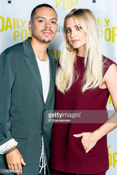 Evan Ross and Ashlee Simpson pose for a photo on set