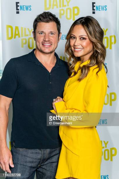 Nick and Vanessa Lachey pose for a photo on set