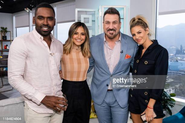 Daily Pop CoHosts Justin Sylvester and Erin Lim pose for a photo with Joey Fatone and CoHost Morgan Stewart on set