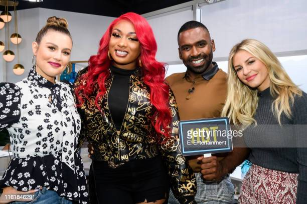 Daily Pop CoHost Carissa Culiner poses with a photo with Rapper Megan Thee Stallion and CoHosts Justin Sylvester and Morgan Stewart on set