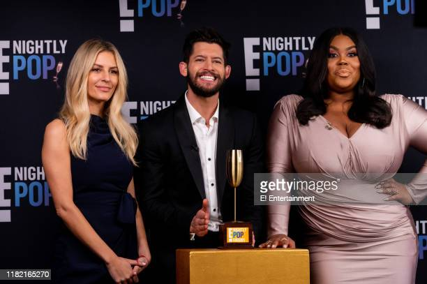 Nightly Pop CoHosts Morgan Stewart Hunter March and Nina Parker pose on set