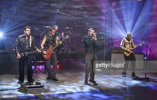Chris Henderson Todd Harrell Richard Liles Brad Arnold and Matt Roberts of the musical guest 3 Doors Down perform on October 27 2000