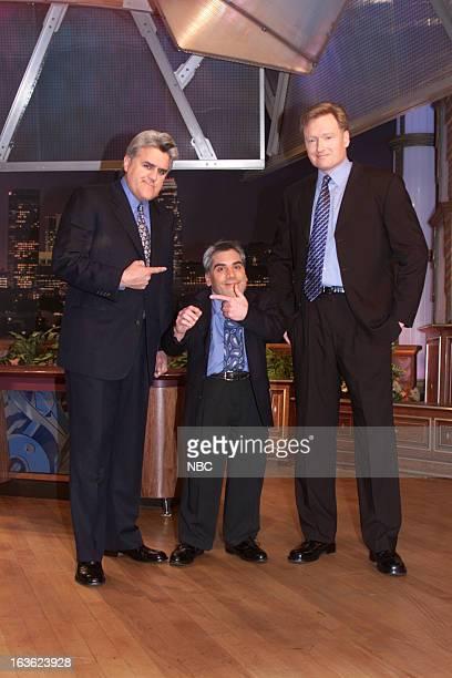 Episode 1984 -- Pictured: Host Jay Leno, a Jay Leno look-alike, Talk show host Conan O'Brien onstage January 23, 2001 --