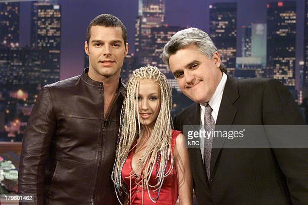 Musical guests Ricky Martin Christina Aguilera with host Jay Leno on February 13 2001