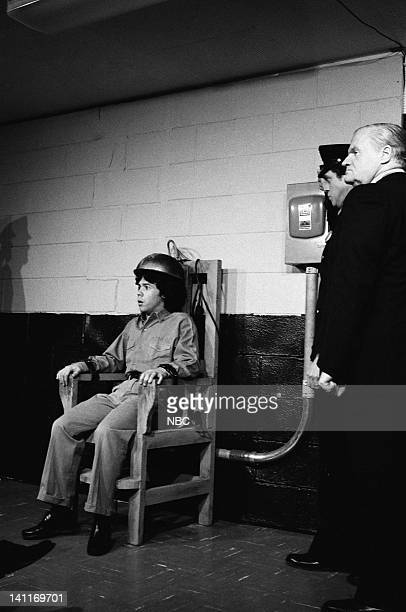 Gilbert Gottfried as Prisoner Joe Piscopo as Executioner during the 'Electric Chair' skit on November 22 1980 Photo by NBC/NBCU Photo Bank