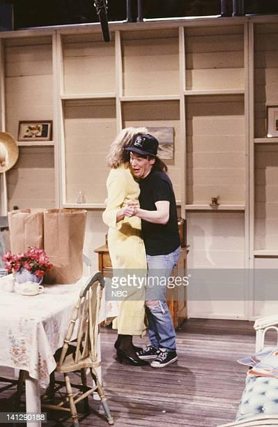 Candice Bergen as Hillary Algar Mike Myers as Wayne Campbell during the 'Wayne's World' skit on May 19 1990 Photo by Raymond Bonar/NBCU Photo Bank