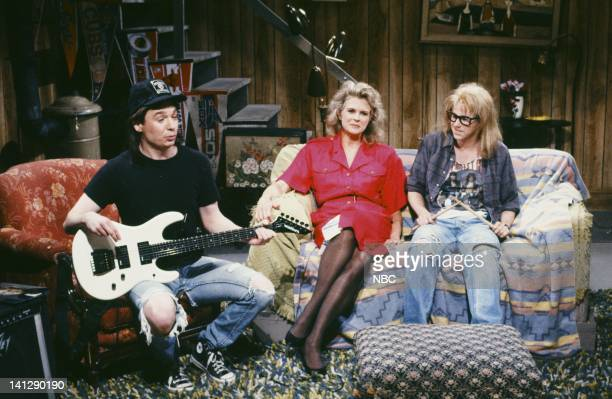 Mike Myers as Wayne Campbell Candice Bergen as Hillary Algar Dana Carvey as Garth Algar during the 'Wayne's World' skit on May 19 1990 Photo by...