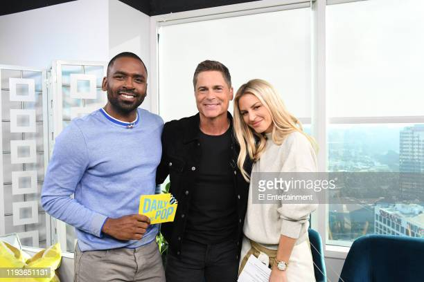 Daily Pop CoHost Justin Sylvester poses for a photo with Rob Lowe and CoHost Morgan Stewart on set