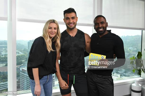 Daily Pop CoHost Morgan Stewart poses for a photo with trainer Sam Asghari and CoHost Justin Sylvester on set