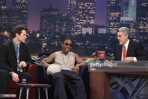 Musician/Actor Chris Isaak Rapper Ja Rule during an interview with Jay Leno on March 1 2001