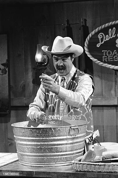 LIVE Episode 21 Air Date Pictured Dan Aykroyd as Kenny Slungard during the 'Dell Stator's 99 Cent Toad Ranch' skit on May 22 1976