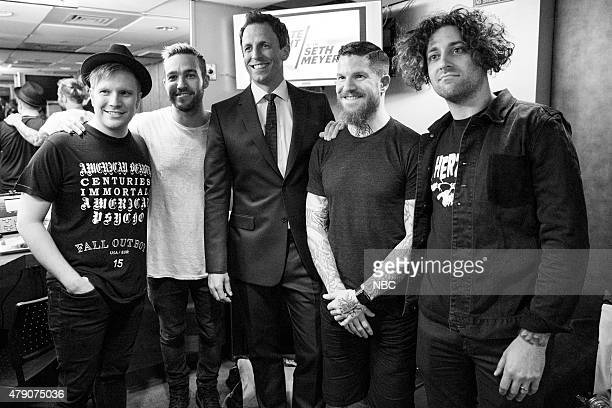 MEYERS Episode 216 Pictured Patrick Stump Pete Wntz Andy Hurley and Joe Trohman of Fall Out Boy with host Seth Meyers backstage on June 8 2015
