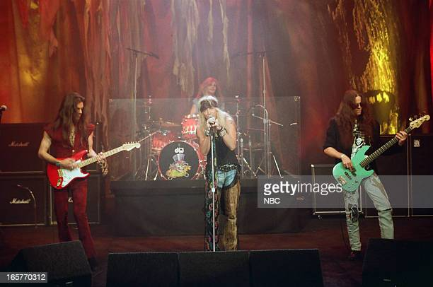 Musical guests Poison CC DeVille Rikki Rockett Bret Michaels Bobby Dall perform on May 7 1993