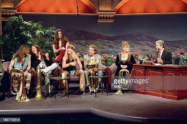 Musical guests Poison Rikki Rockett Bobby Dall CC DeVille Bret Michaels actor Eric Idle model Paulina Porizkova during an interview with host Jay...
