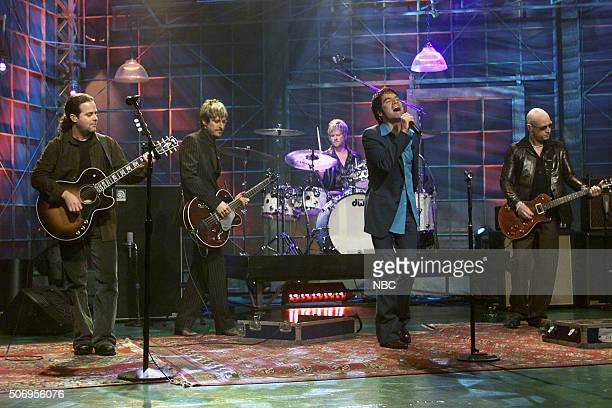 Rob Hotchkiss Charlie Colin Scott Underwood Patrick Monahan and Jimmy Stafford of rock band Train perform on February 28 2002