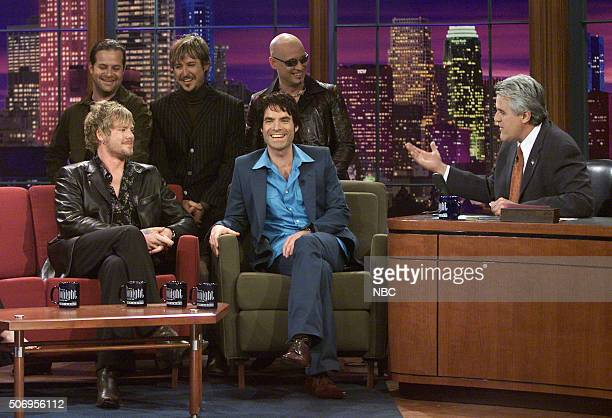 Rob Hotchkiss Charlie Colin Scott Underwood Patrick Monahan and Jimmy Stafford of rock band Train during an interview with host Jay Leno on February...