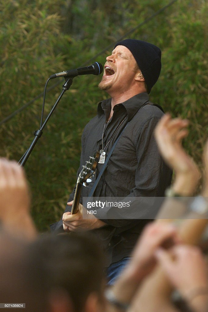 Guitarist David Bryson of rock band Counting Crows performs on August 2, 2002 --