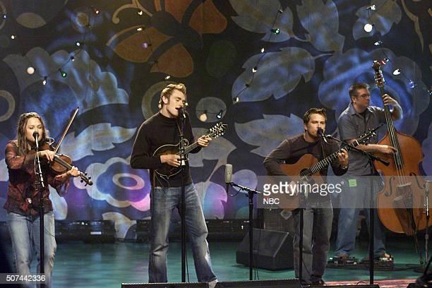 Musicians Sara Watkins Chris Thile and Sean Watkins of musical trio Nickel Creek perform on September 17 2002
