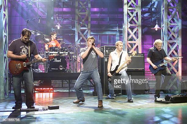 Musicians Chris Henderson Daniel Adair Brad Arnold Matt Roberts and Todd Harrell of rock band 3 Doors Down perform on November 14 2002