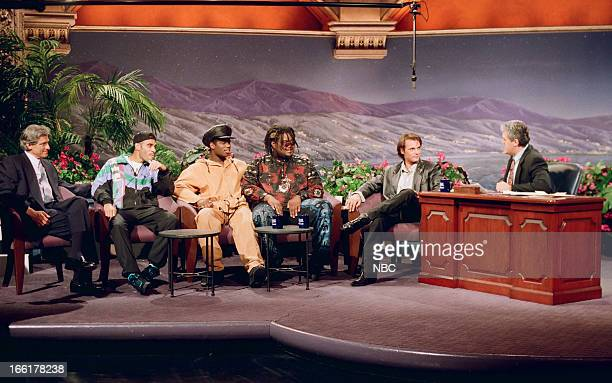 Talk show host Maury Povich musical guests PM Dawn actor James Wilder during an interview with host Jay Leno on June 4 1993