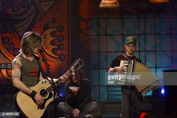 Musical guests John Rzeznik Robby Takac and Mike Malinin of the Goo Goo Dolls perform on January 30 2003