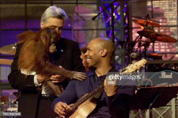 Host Jay Leno and crew member Kevin Eubanks during an animal segment on May 1 2003