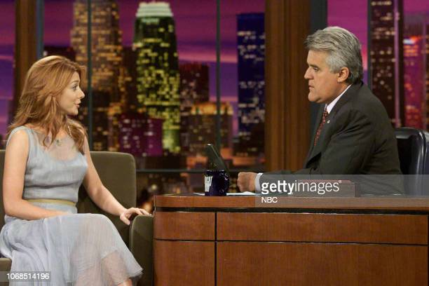Actress Alyson Hanniganon during an interview with host Jay Leno August 1 2003