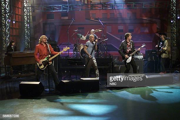 Musicians Ken Stringfellow Mike Mills Michael Stipe Bill Rieflin Peter Buck and Scott McCaughey of rockband REM perform