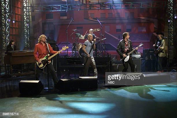 Musicians Ken Stringfellow Mike Mills Michael Stipe Bill Rieflin Peter Buck and Scott McCaughey of rockband REM perform on October 28 2003