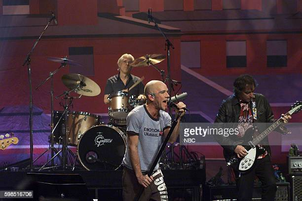 Musicians Michael Stipe Bill Rieflin and Peter Buck of rockband REM perform on October 28 2003
