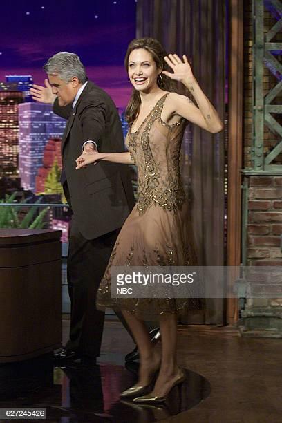 Host Jay Leno greets actress Angelina Jolie on March 16 2004