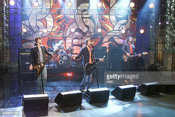 Cameron Muncey Chris Cester Nic Cester and Mark Wilson of musical guest Jet perform on April 9 2004