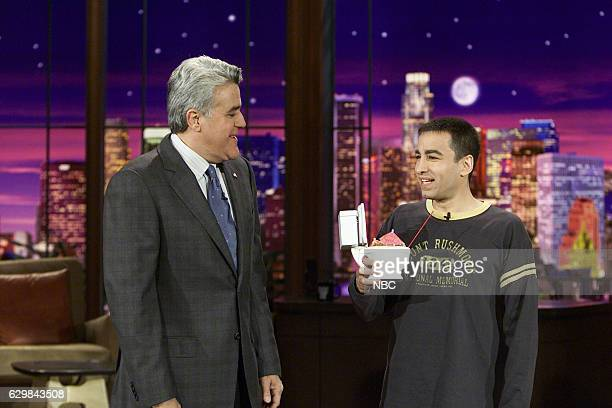 Host Jay Leno and comedian Mitch Fatel during an opening segment on November 24 2004
