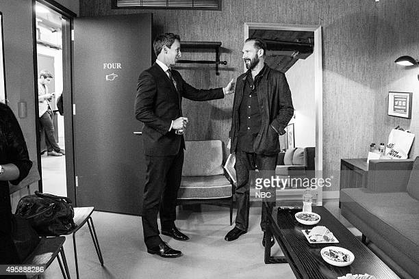MEYERS Episode 283 Pictured Host Seth Meyers talks with actor Ralph Fiennes backstage on November 4 2015