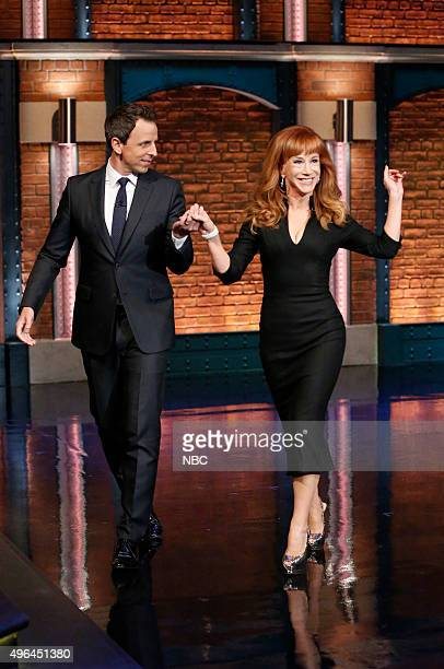 Host Seth Meyers greets comedian Kathy Griffin on November 9 2015