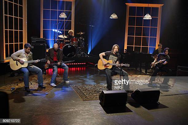 Singer Keith Urban performs with band on June 6 2005