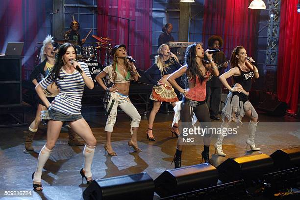 Singers Kimberly Wyatt Jessica Sutta Melody Thornton Ashley Roberts Nicole Scherzinger and Carmit Bachar of pop group The Pussycat Dolls perform on...