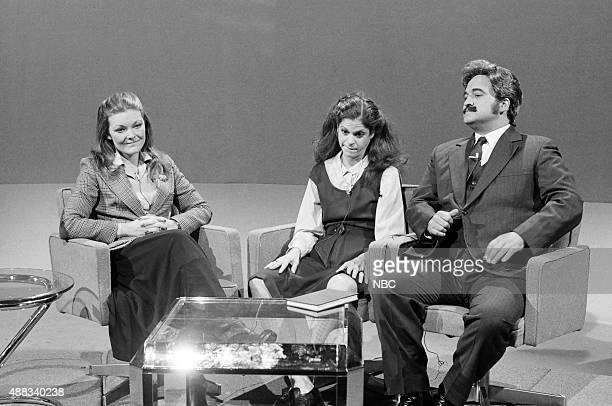 Jane Curtin Gilda Radner as Colleen Fernman John Belushi as Michael Mykonos during the '3 R's' skit on October 15 1977