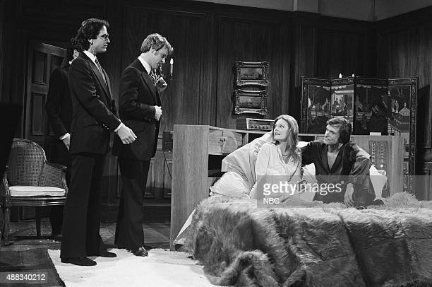 Tom Davis as Secret Service agent Dan Aykroyd as Jimmy Carter Jane Curtin as student Hugh Hefner during the 'Circular Bed Sex Research' skit on...