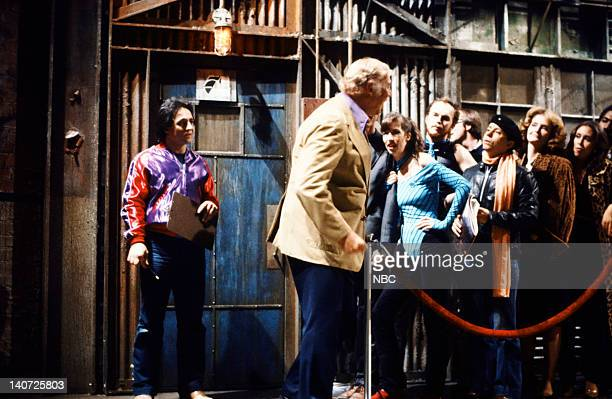Tony Rosato as Doorman and George Kennedy during the '53 at Studio 54' skit on October 17 1981