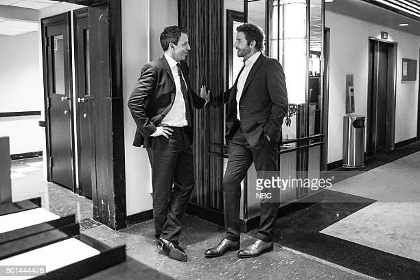 MEYERS Episode 301 Pictured Host Seth Meyers talks with actor Bradley Cooper backstage on December 14 2015