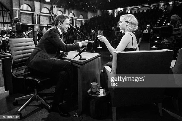 MEYERS Episode 302 Pictured Host Seth Meyers and actress Jennifer Lawrence during a commercial break on December 15 2015