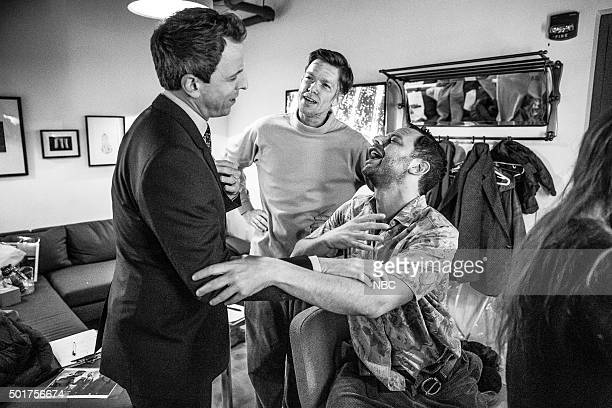 MEYERS Episode 303 Pictured Host Seth Meyers talks with comedians John Mulaney and Nick Kroll backstage on December 16 2015