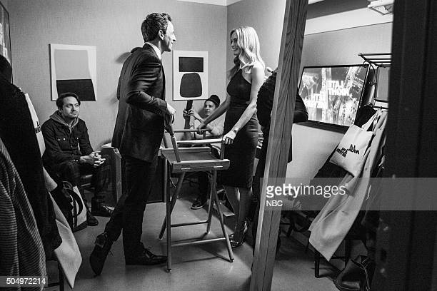 MEYERS Episode 311 Pictured Host Seth Meyers talks with actress Heather Graham backstage on January 13 2016